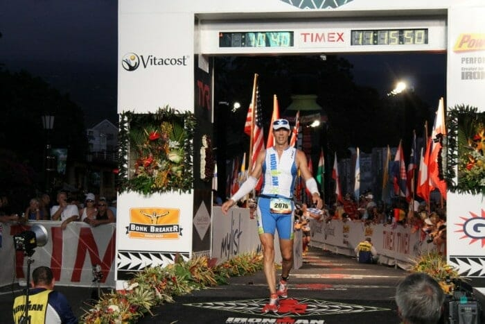 crossing the finish line at ironman wc kona