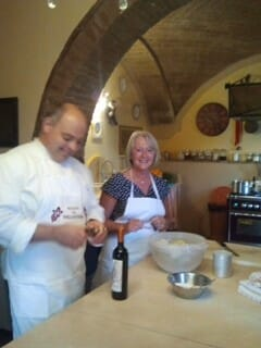enjoying girlfriend travel at a cooking class in Italy