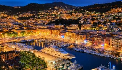 a view of the Old Port harbor in Nice at night